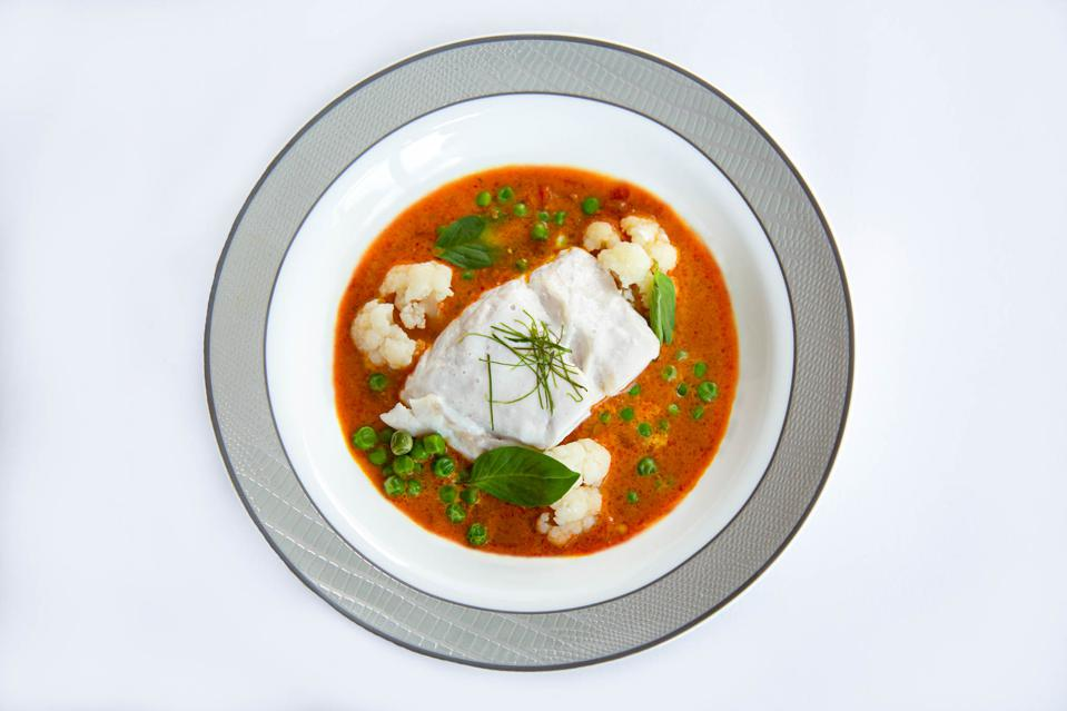 Coconut Poached Fish is a new dish on Singapore Airlines designed in collaboration with Como Shambhala.