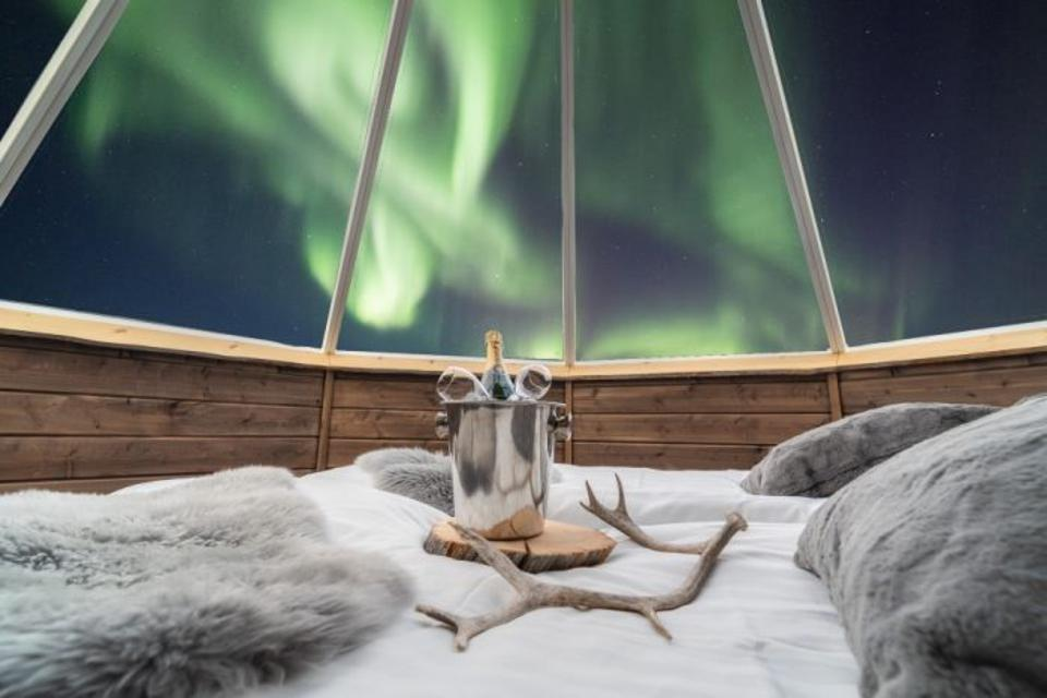 Stay in a wilderness hotel with a view of the Northern Lights.