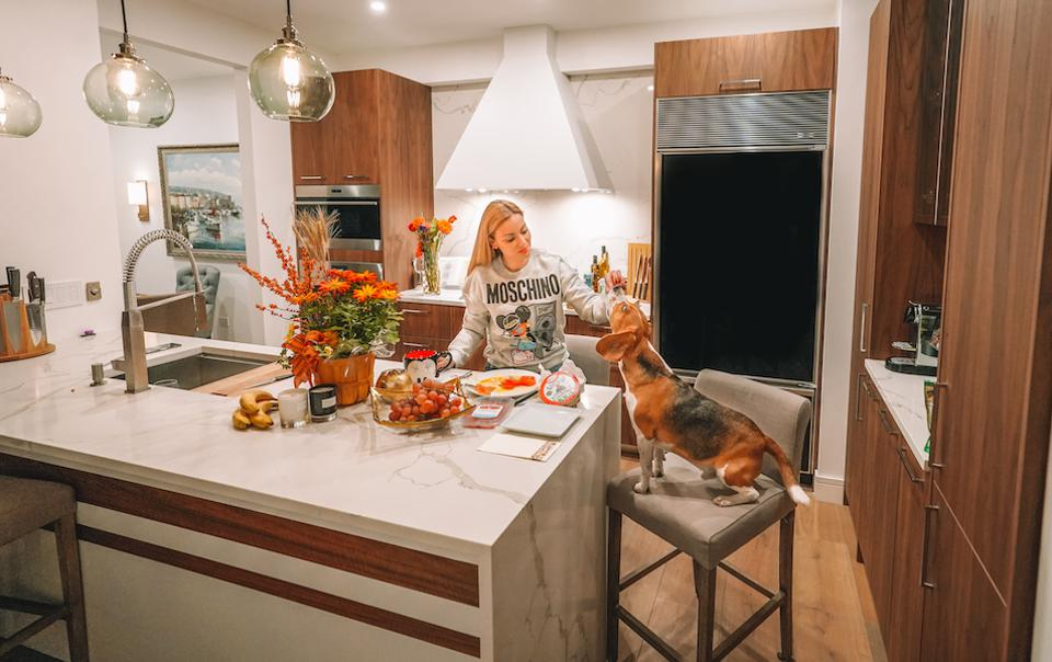 Dr. Emilia D. Taneva in the kitchen of her Chicago apartment with Max.