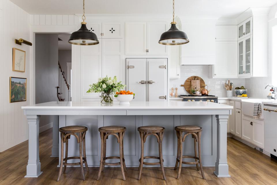 This Big Chill refrigerator and dish washer are unique giving this kitchen an updated country  charm.