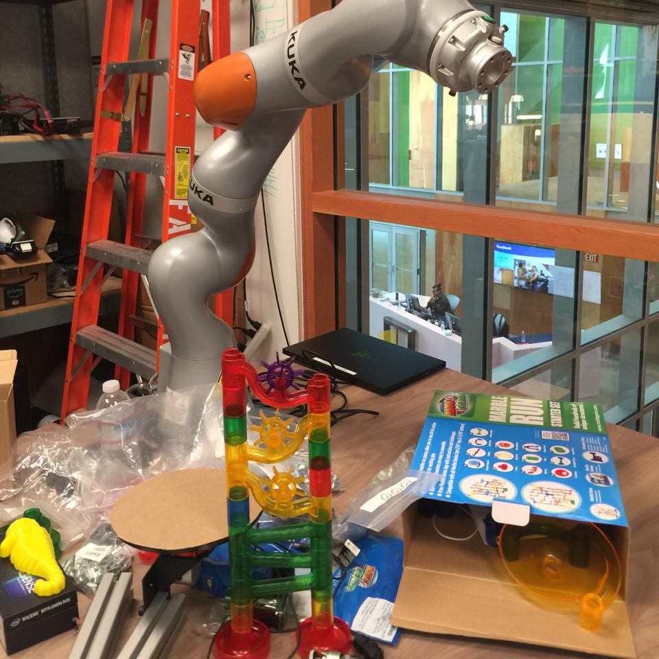 Facebook's robotic arm, Cleo, with stacked toy