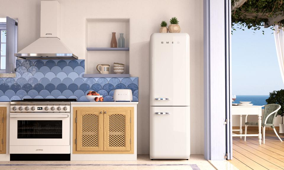 This shows SMEGs' White Portofino Range and refrigerator.