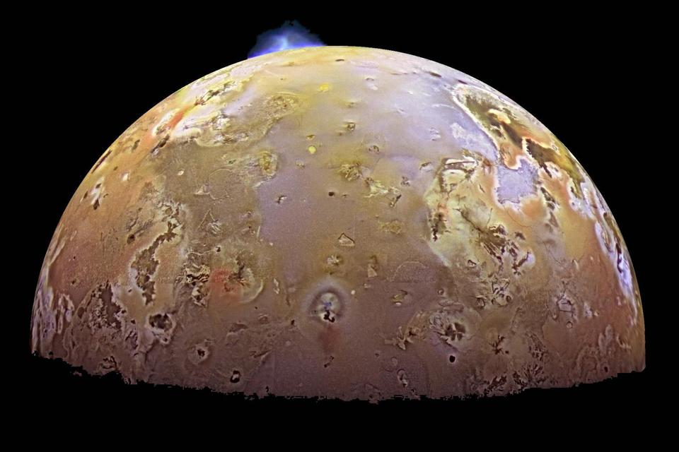 This color image, acquired during Galileo's ninth orbit (C9) around Jupiter, shows two volcanic plumes on Io. One plume was captured on the bright limb or edge of the moon, erupting over a caldera (volcanic depression) named Pillan Patera.
