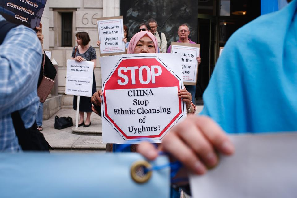 Members and supporters of the Uighur community in the U.K. mark the 10th anniversary of the 2009 Urumqi riots outside the Chinese Embassy in London on July 5, 2019