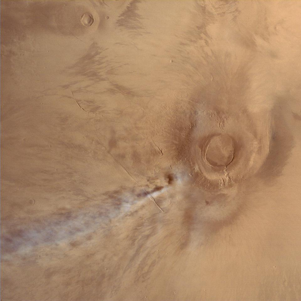 Mars Orbiter Mission image of the Tharsis volcano Arsia Mons, with an orographic cloud streaming away to the southeast. This image was taken by the orbiter on January 4, 2015, while the spacecraft was at an altitude of 10800 km.