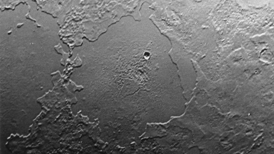 Part of the complex geologic history of icy Triton, Neptune's largest satellite, is shown in this Voyager 2 photo, which has a resolution of 900 meters (2,700 feet) per picture element.