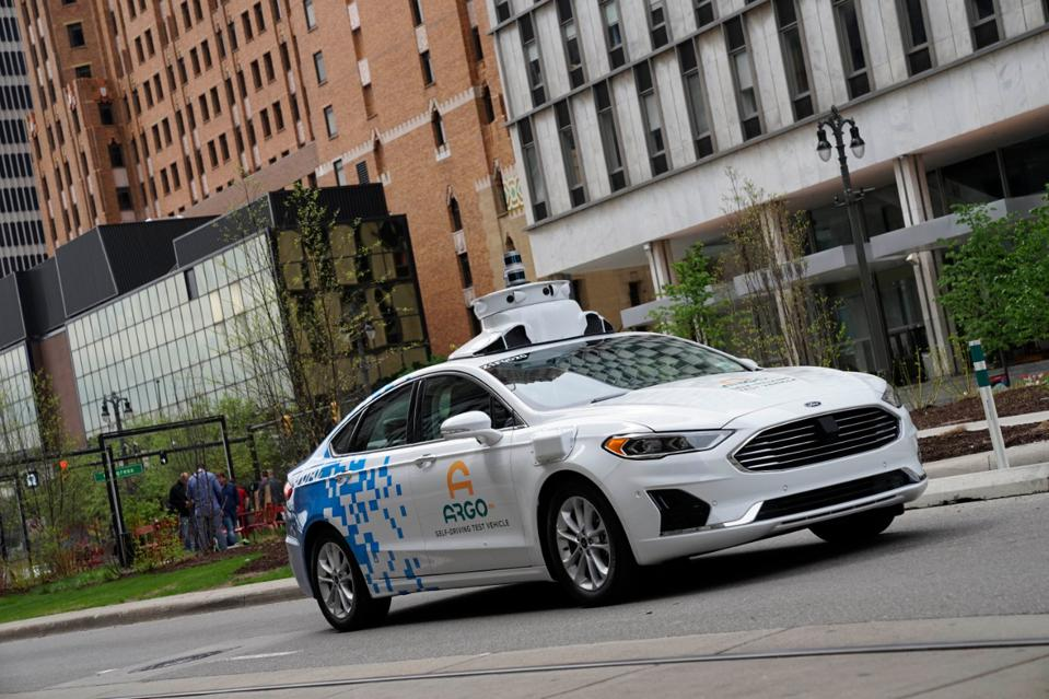 Ford third-generation automated driving test vehicle with bug-washing system
