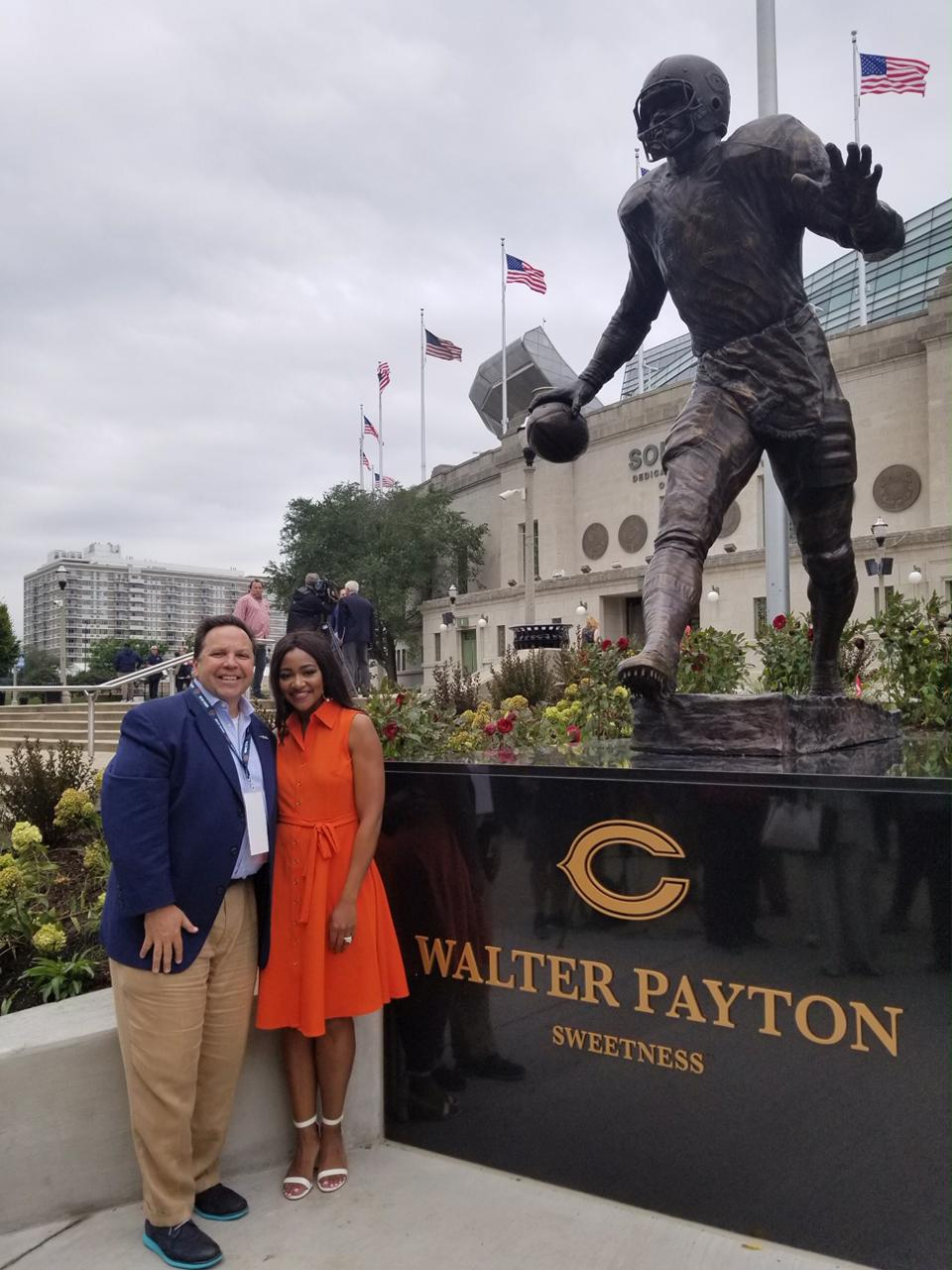 Don Yaeger with Brittney Payton, daughter of Walter Payton.