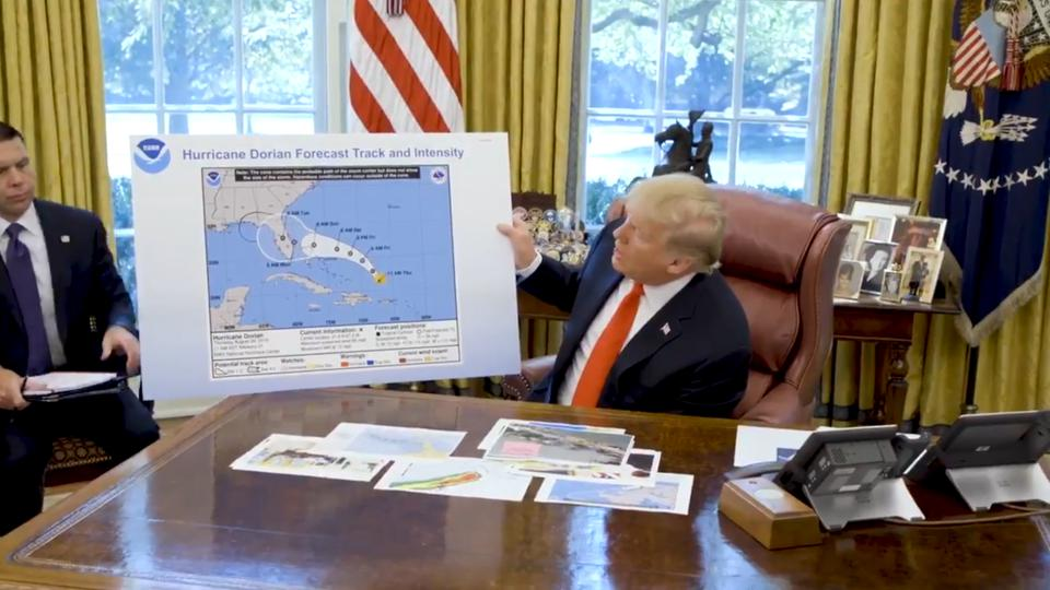 President Trump shares an altered NHC forecast map during a briefing on Hurricane Dorian.