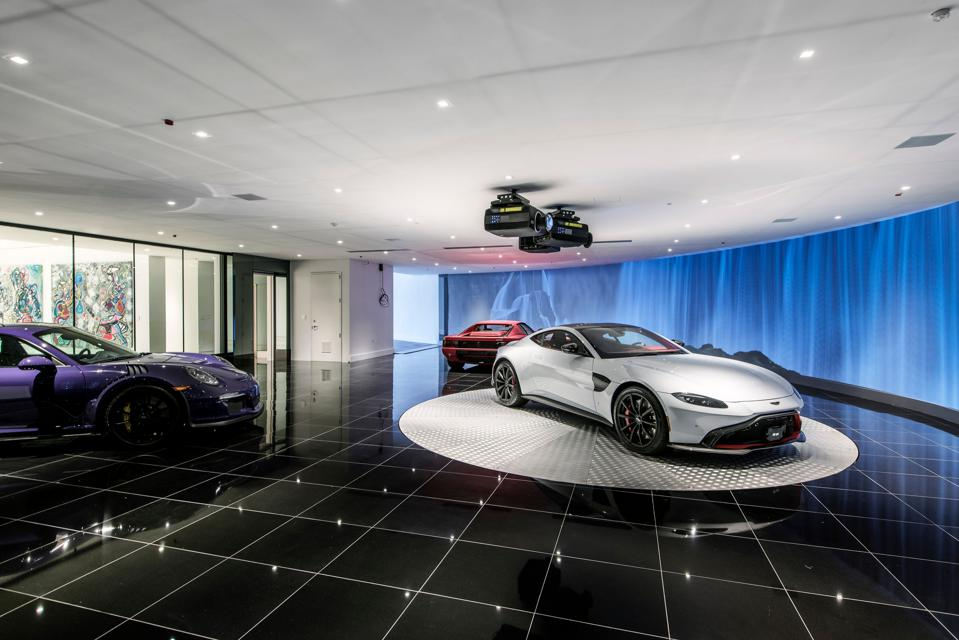 The McLaren, Aston Martin and Porsche that come with the listing.