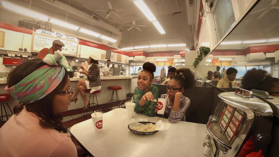 Image shows young girls at Ben's Chili Bowl in 'Traveling While Black'