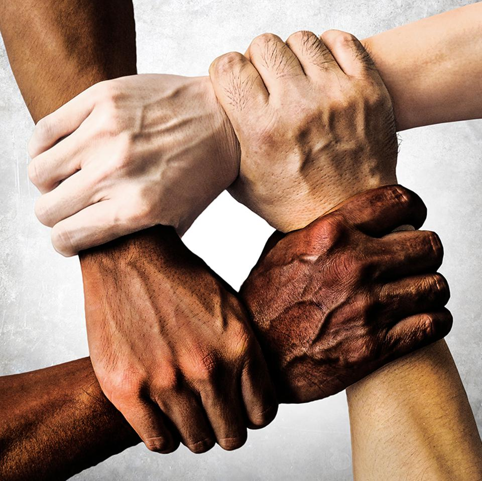 Multiple hands clasped as a symbol of toleration