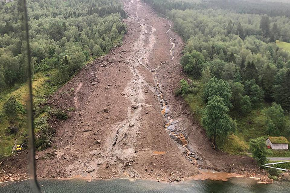 A landslide in July 2019 completely covered a rural road in Jølster, Norway.
