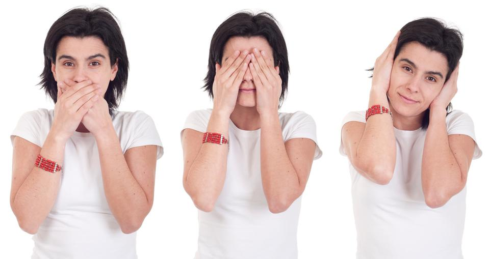 A woman seen three times, once covering her mouth, once covering her eyes and once covering her ears.