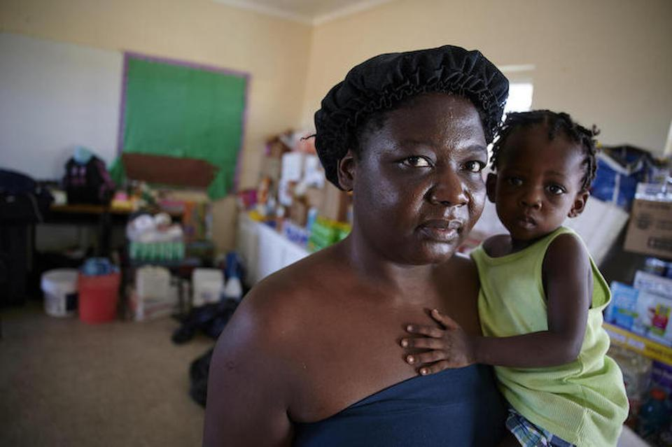 Single mother Maxenat Gerda and her 16-month-old daughter, Christ Bernaida, have taken shelter in a classroom at the Central Abaco Primary School.