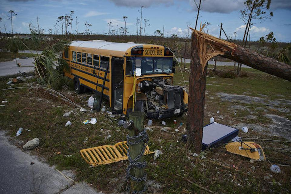 A damaged school bus sits outside St. Francis Church in Marsh Harbour, Abaco Island.