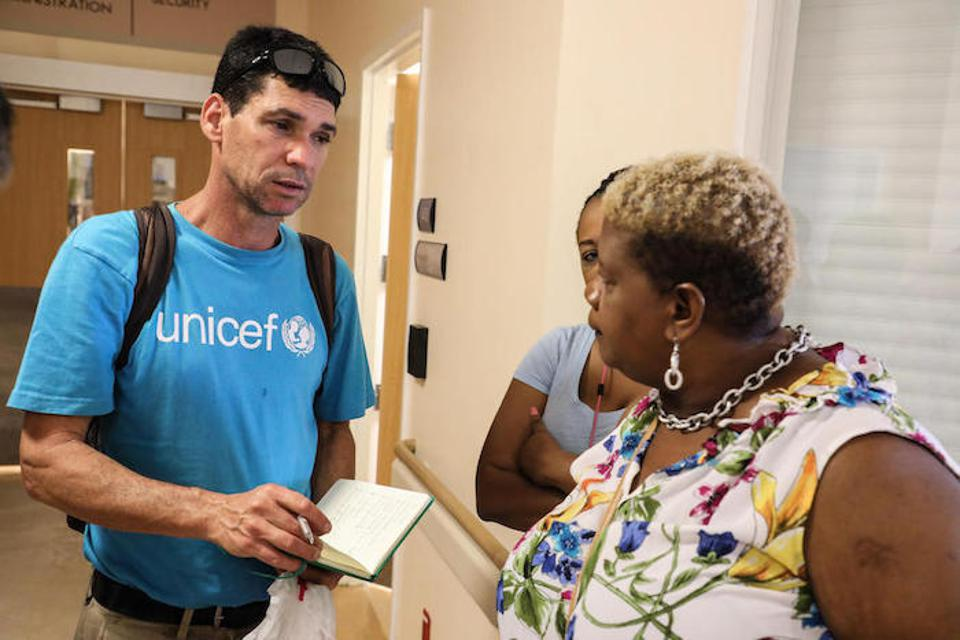 UNICEF Regional Emergency Specialist Hanoch Barlevi talks with a nurse in one of the main hospitals of Marsh Harbour Town, Abaco Island, the Bahamas.