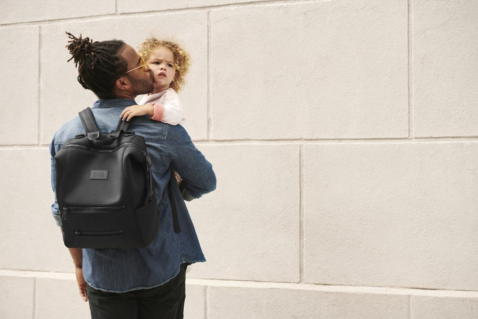 A dad wearing the Dagne Dover Indi Diaper Backpack