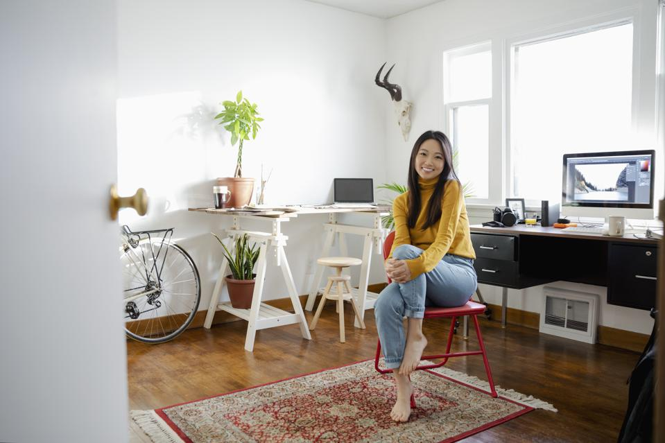 Portrait confident young woman working in home office