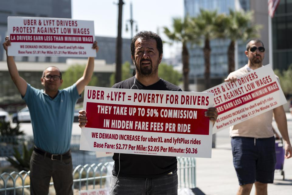 Uber and Lyft drivers march in a September 2017 protest in Los Angeles.
