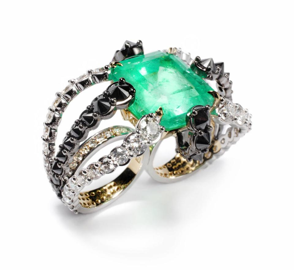 18kt yellow and white gold double finger Octopus ring, with a 31.85ct Octagon emerald, 5.67ct of black diamonds and 7.94ct of white diamonds. Price on application.