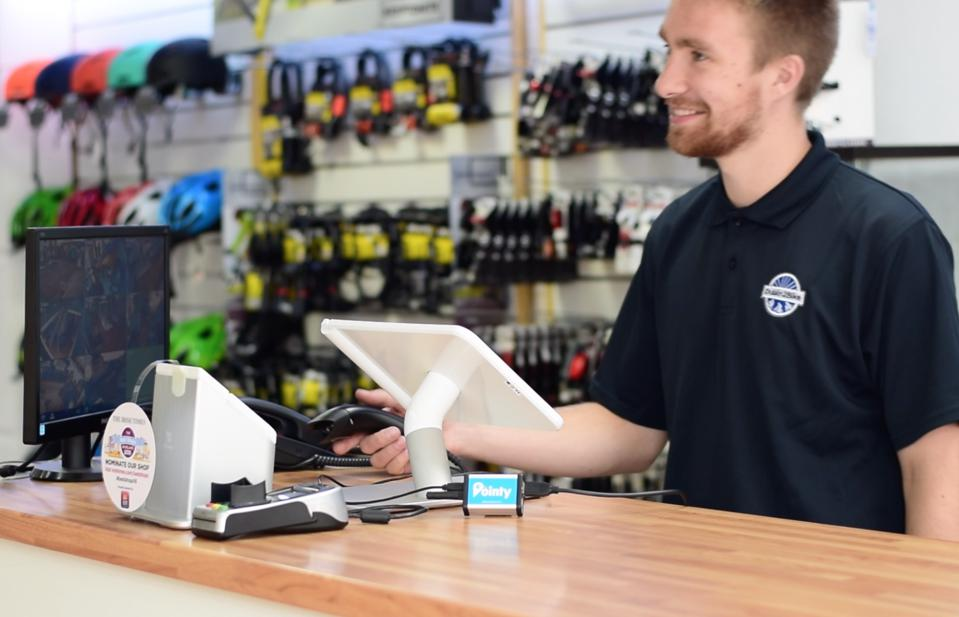 A photo of a sporting goods store using the Pointy device with its point-of-sale system.