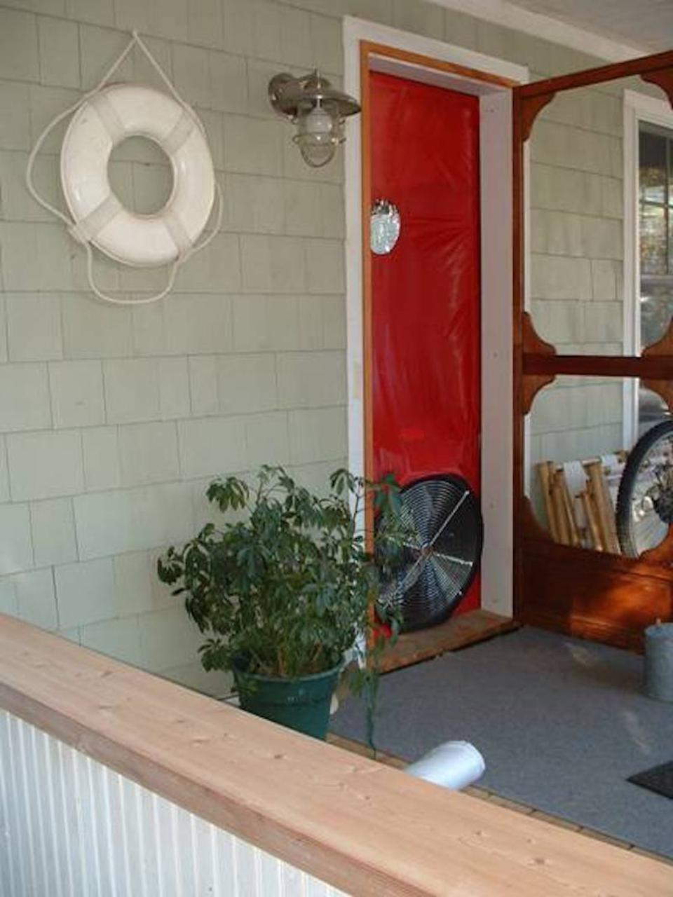 A blower door test is being conducted in this newly renovated home in Lakeside, Ohio.