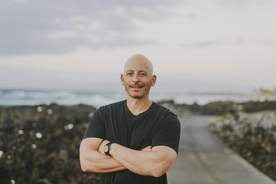 bald man in black t-shirt