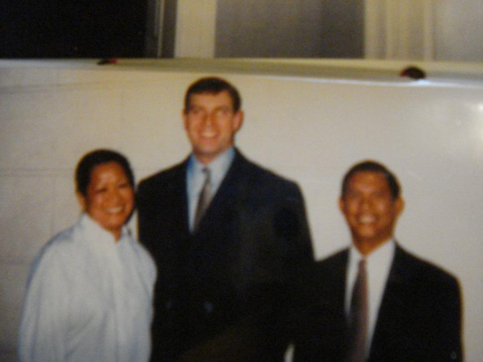 The Fontanillas with Prince Andrew, center.