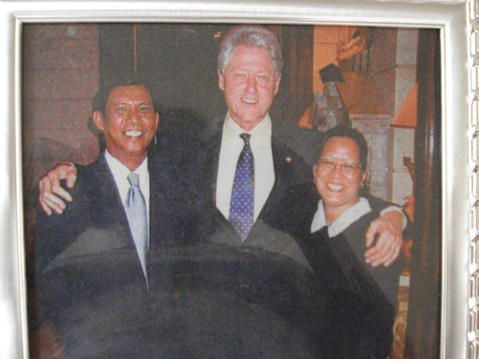 Jojo Fontanilla, left, and Jun-Lyn Fontanilla, right, with Bill Clinton, center. The Fontanillas worked for Epstein.