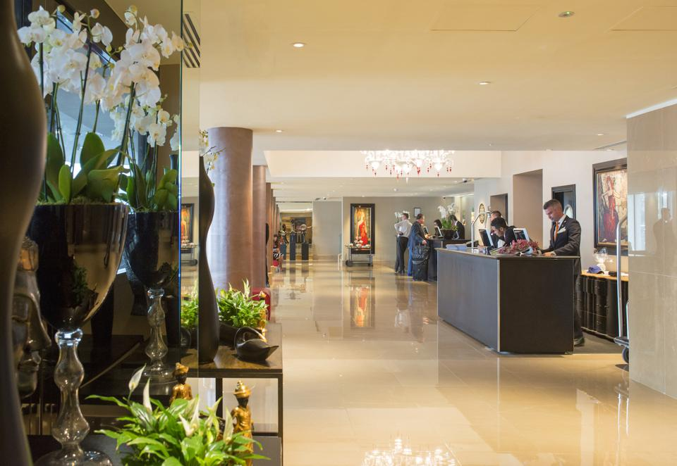 The May Fair Hotel operates much like a bespoke boutique hotel with a high level of personalized guest services. Seen here is The May Fair Hotel's glamorous lobby.