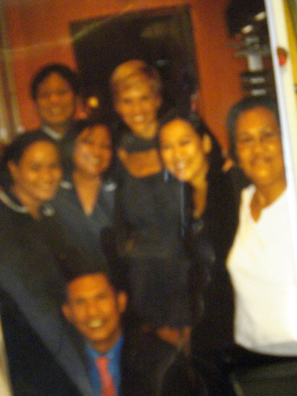 The Fontanillas, plus other unidentified individuals, with Hilary Swank (center, blonde hair.)
