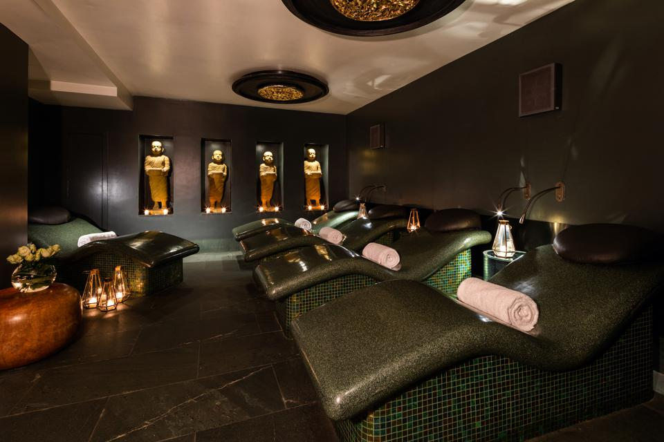 The May Fair Spa's candlelit relaxation room features heated beds.