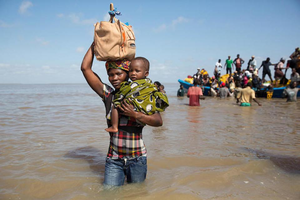 On March 29, 2019 in Mozambique, Dorinda Antonio and her son, Manuel, arrive by boat in Beira from Buzi, one of the areas most severely affected by Cyclone Idai.
