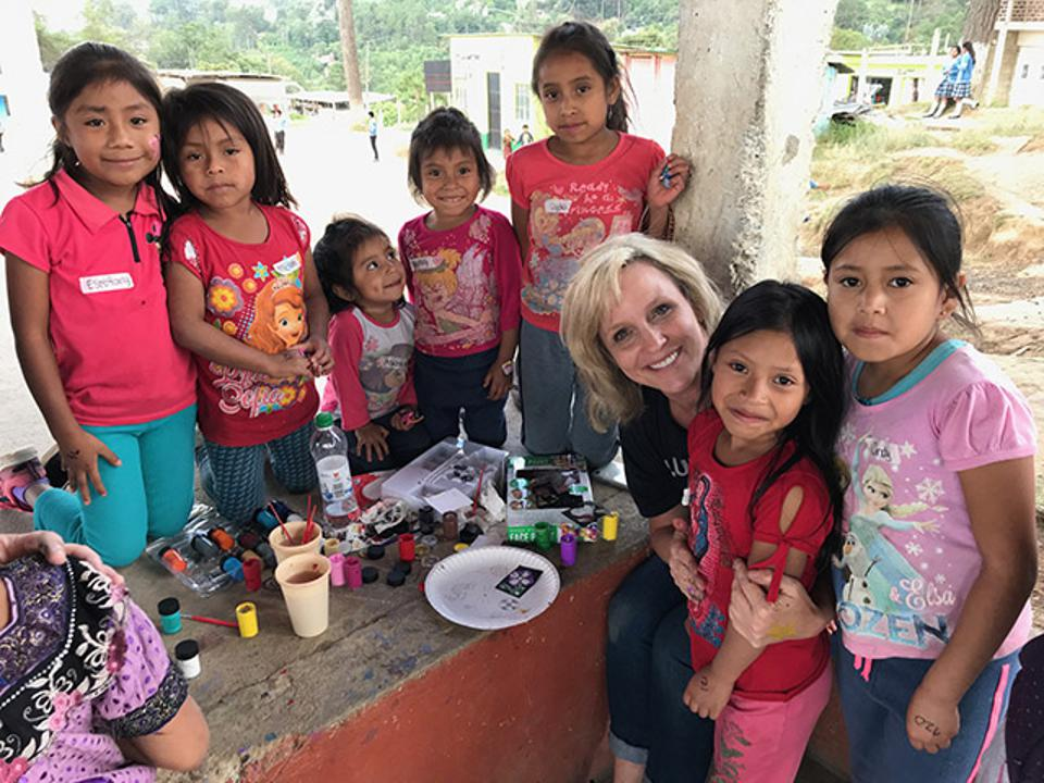Cheryl Gochis, Baylor's chief human resources officer, joined Baylor students on a mission trip to Guatemala, where they worked with undernourished children in a program sponsored by One More Child Global.