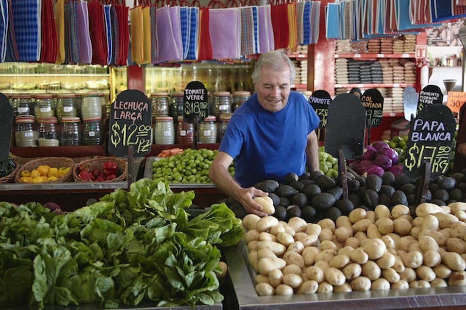 Chef Pepin shopping in a market