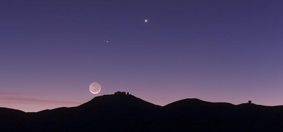 A crescent Moon and the planets Mercury and Venus over the European Southern Observatory's (ESO) Paranal Observatory in Chile.