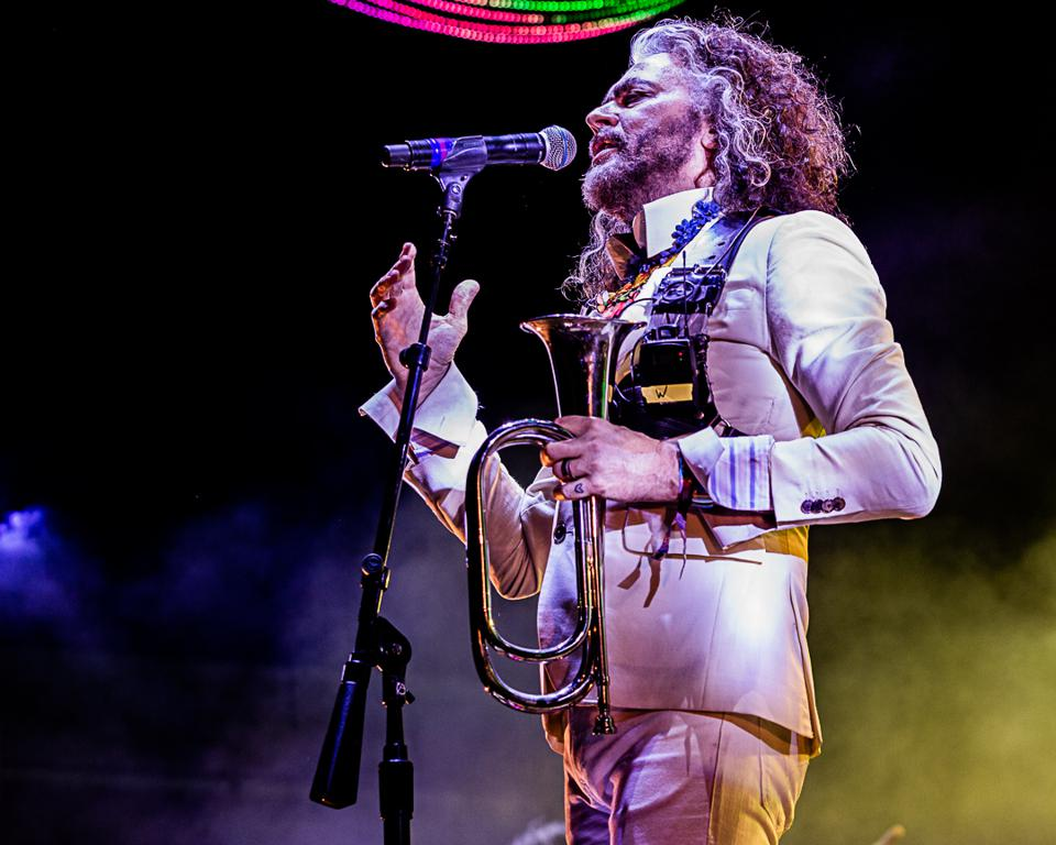 Flaming Lips vocalist Wayne Coyne on stage during Riot Fest's 15th anniversary celebration. Friday, September 13, 2019 at Douglas Park in Chicago (Photo by Philamonjaro Studio)