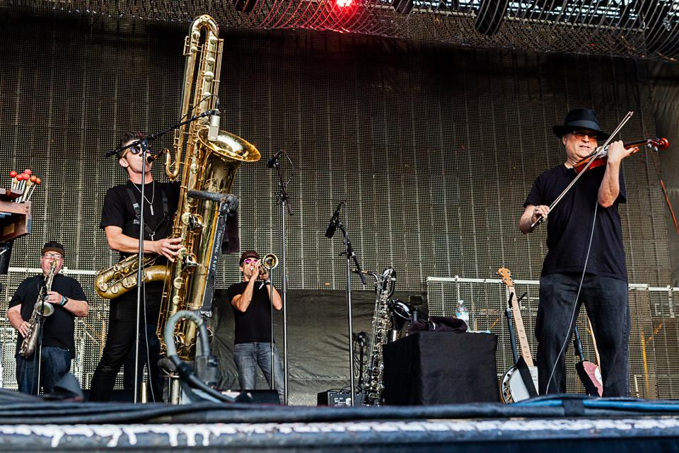 The Violent Femmes perform with their Horns of Dilemma, featuring Chicago saxophonist Frank Catalano (back, left), during the 15th anniversary of Riot Fest in Chicago. Friday, September 13, 2019 in Douglas Park (Photo by Philamonjaro Studio)