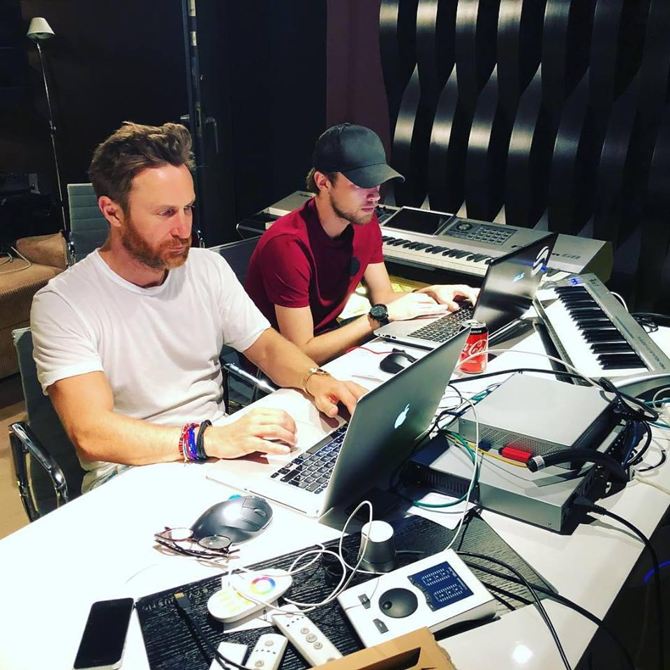 David Guetta and Brooks working in the studio together.