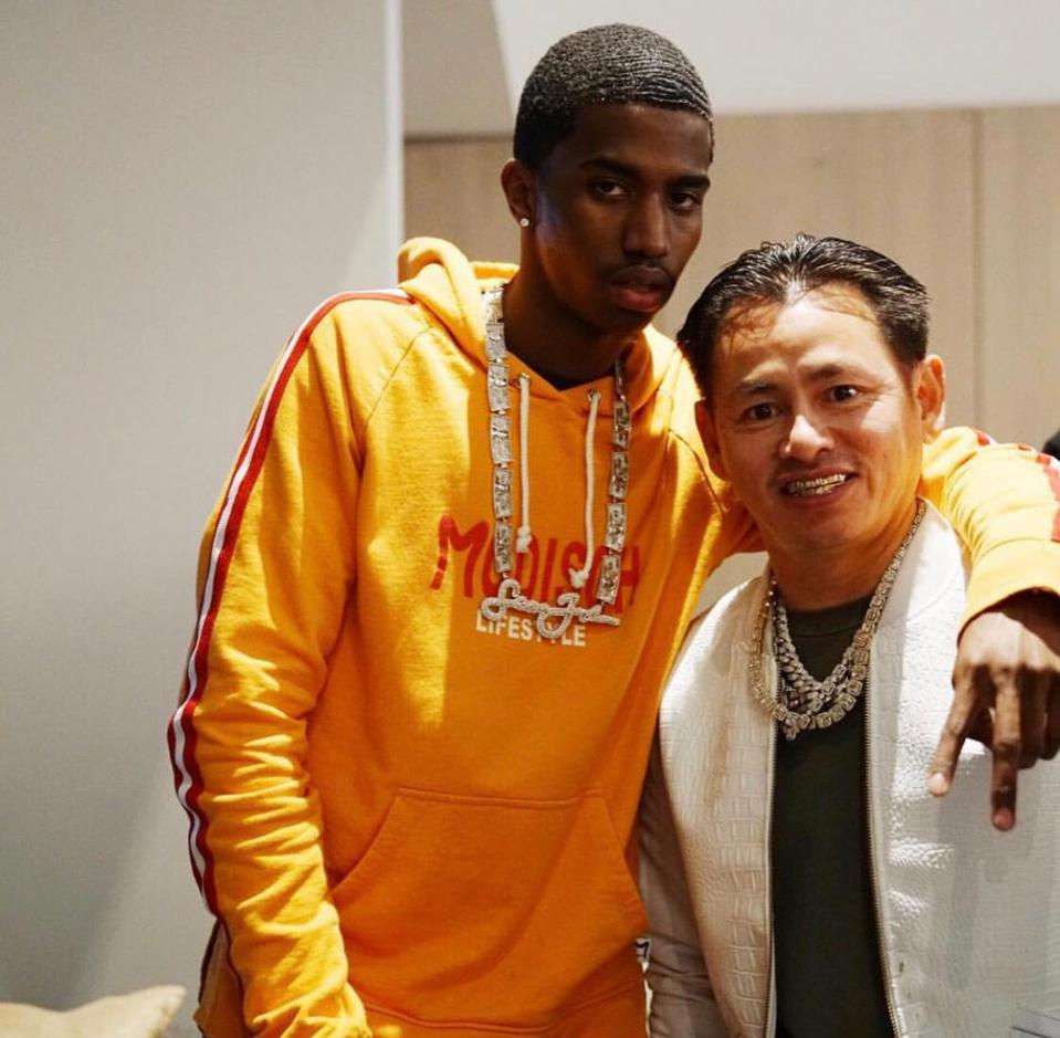 Diddy's son, King Combs standing with Johnny Dang