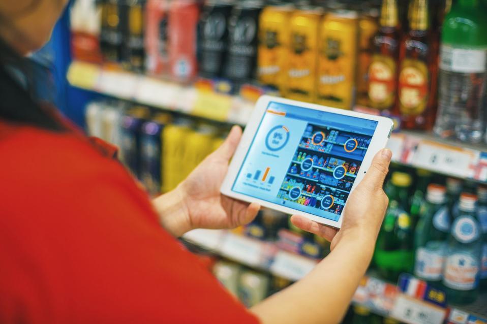 A store employee has Simbe Robotics' analytics at hand