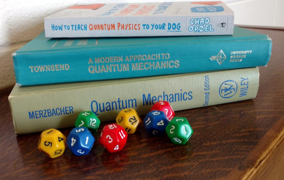 Quantum physics books with dice.