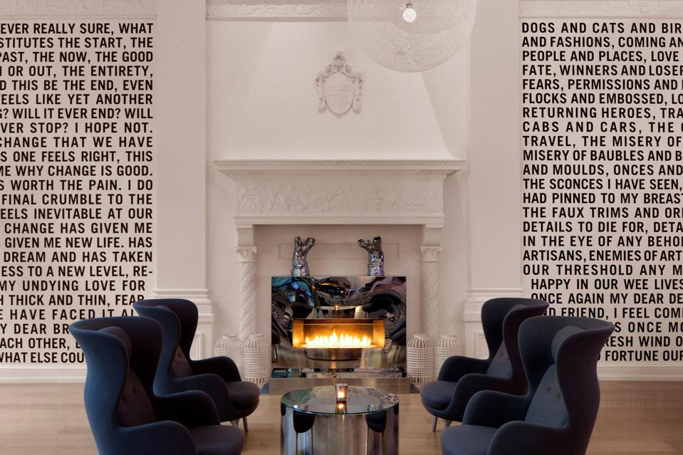 black chairs by white fireplace