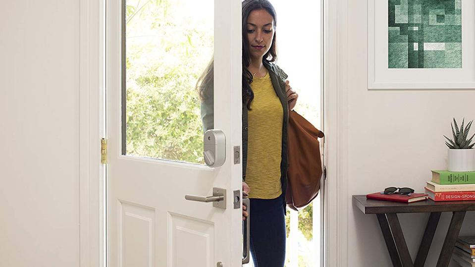 Person entering home with August Smart Lock.