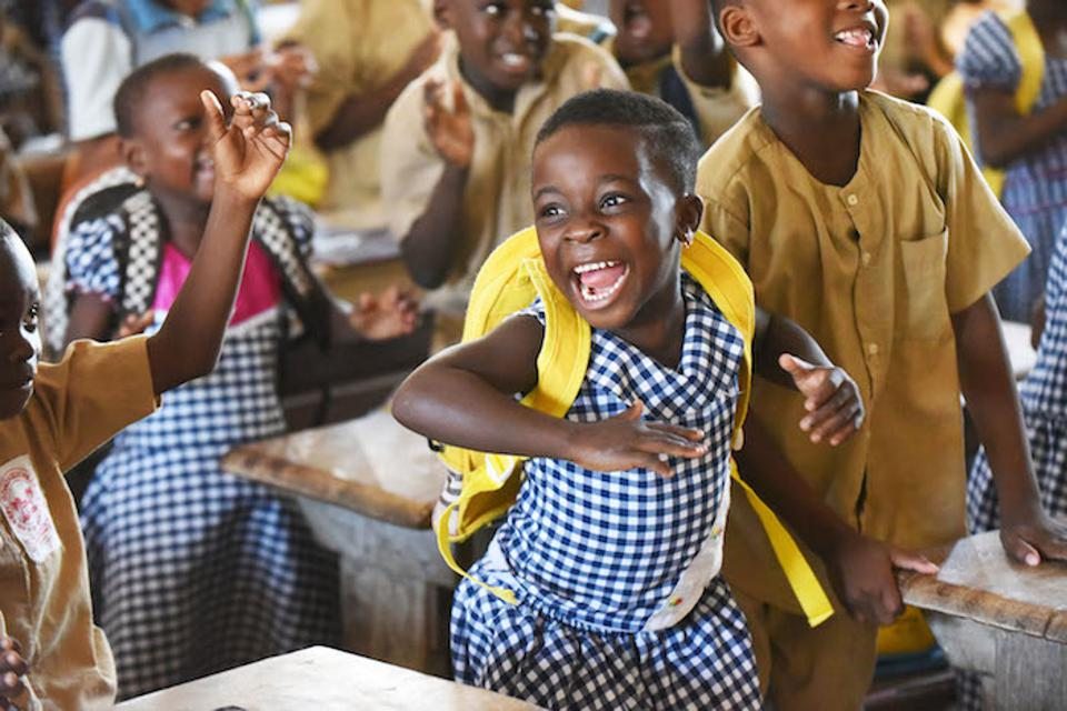 Students get excited during a classroom activity at a UNICEF-supported school in Gonzagueville, in southern Côte d'Ivoire.