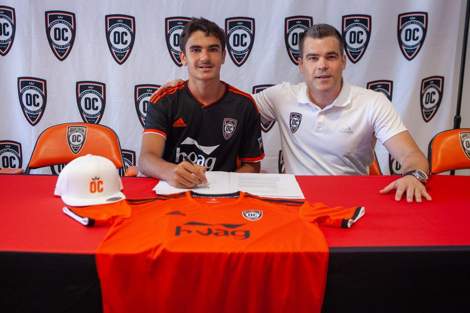 Image of Francis Jacobs with Orange County SC president of soccer operations and general manager, Oliver Wyss.