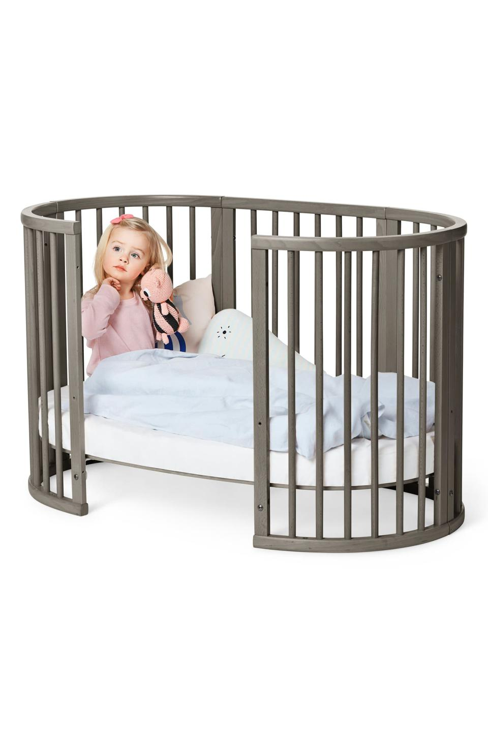 a crib with a child in it