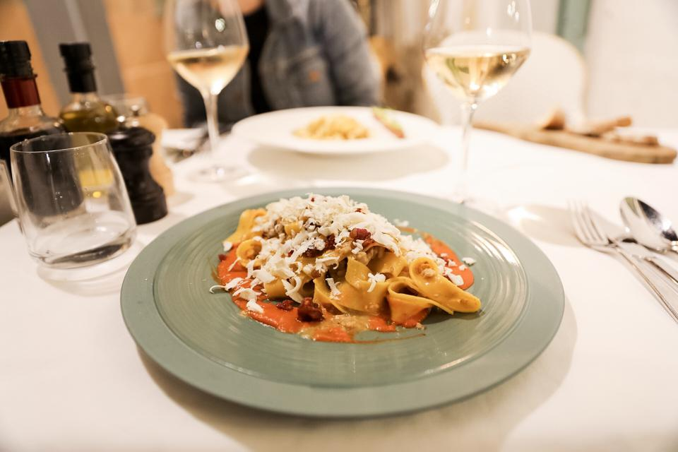 ST. TROPEZ -  Fettuccine with ragu from the centre of Italy, cream of red peppers, Taggiasca olives and toasted pine nuts at Dolceva