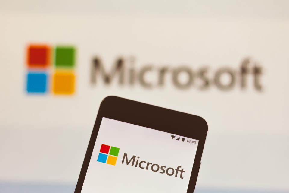 In this photo illustration the Microsoft logo seen displayed...
